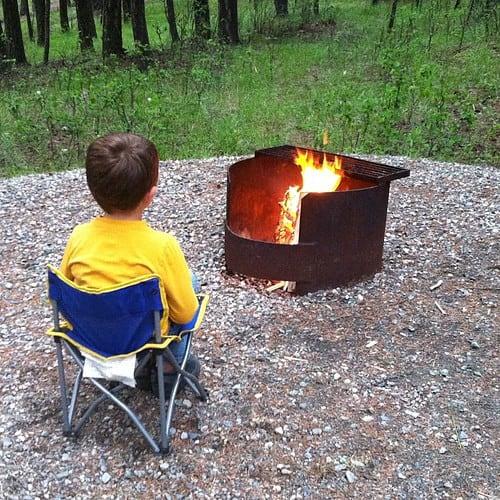 Evan by a campfire