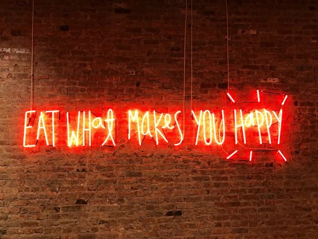Neon eat what makes you happy sign