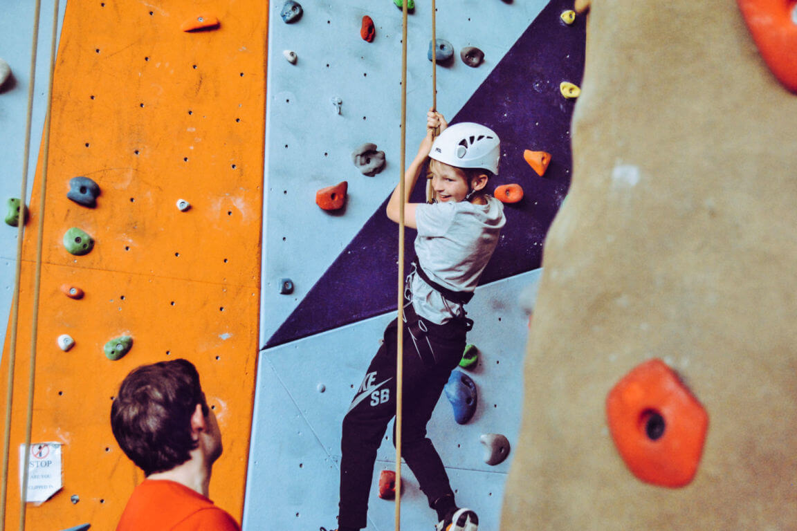 Active Birthday parties in calgary - Boy on climbing wall