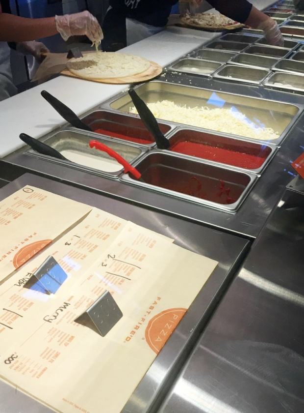 Building your pizza at Blaze