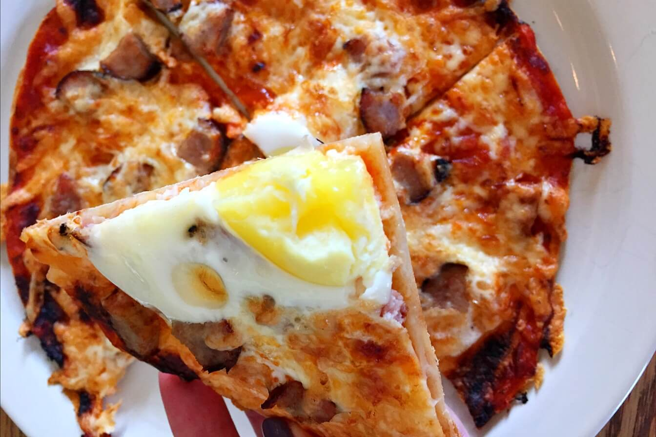 deep fried breakfast pizza with sausage eggs parmesan and hollandaise ...
