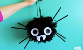 Giant Pom Pom Spiders for DIY Halloween Decorations