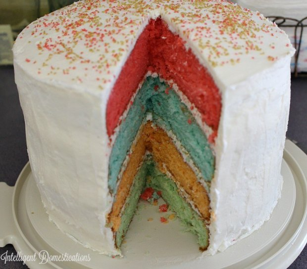 Rainbow-layer-cake-is-four-layers-of-flavor-and-beauty.-Perfect-for-Easter-dessert.intelligentdomestications.com_