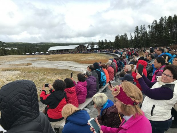 All the people waiting to see Old Faithful at Yellowstone