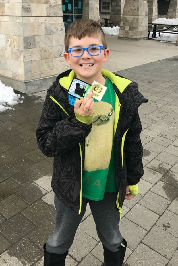 EAringing His Young Scientist and Jr Ranger Badges at Yellowstone