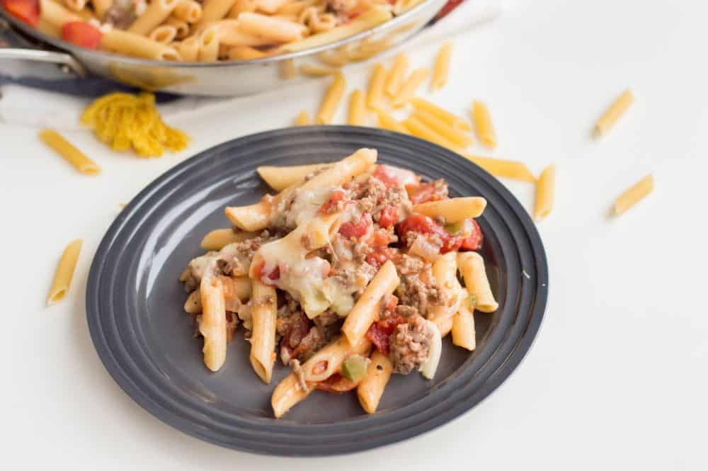 Cheeseburger pasta on a grey plate