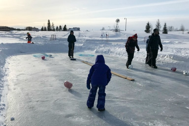 Curling with frozen milk jugs