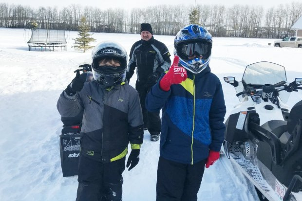 Getting ready to go snowmobiling on Gull Lake in Alberta