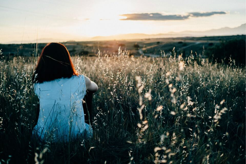 mental health awareness - girl watching a sunset