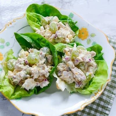 Chicken pear grape salad on lettuce leaves