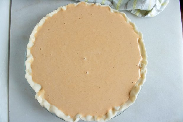 Creamy pumpkin pie ready to bake