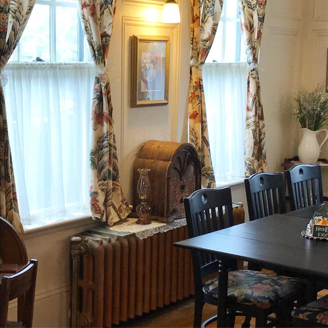 A delightful dining space filled with antiques