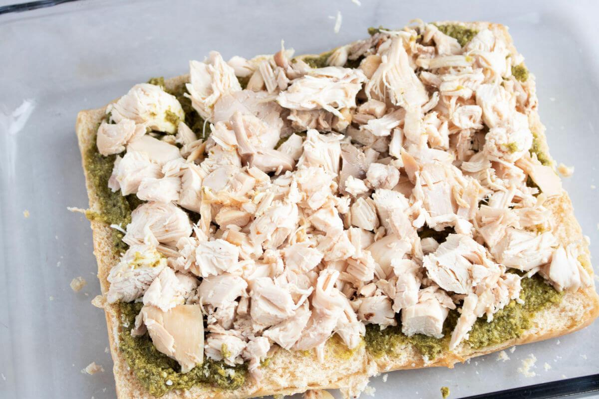 Add chopped chicken to pesto slider buns