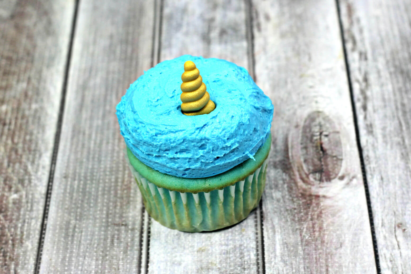 Add unicorn horn to narwhal cupcake
