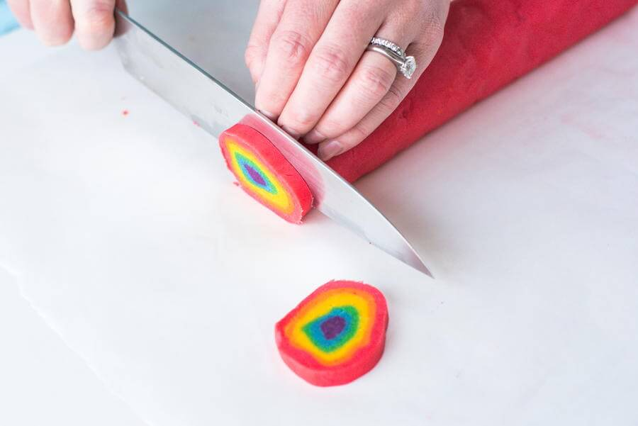 slicing rainbow cookie dough