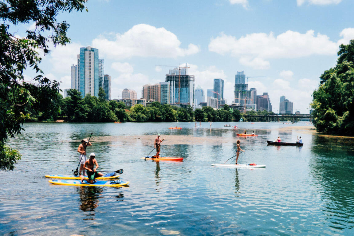 Paddle boarding on a lake in Austin