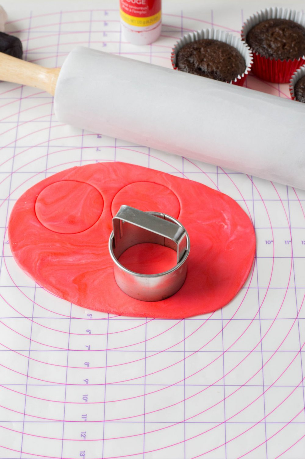 Use a cookie cutter to cut red fondant