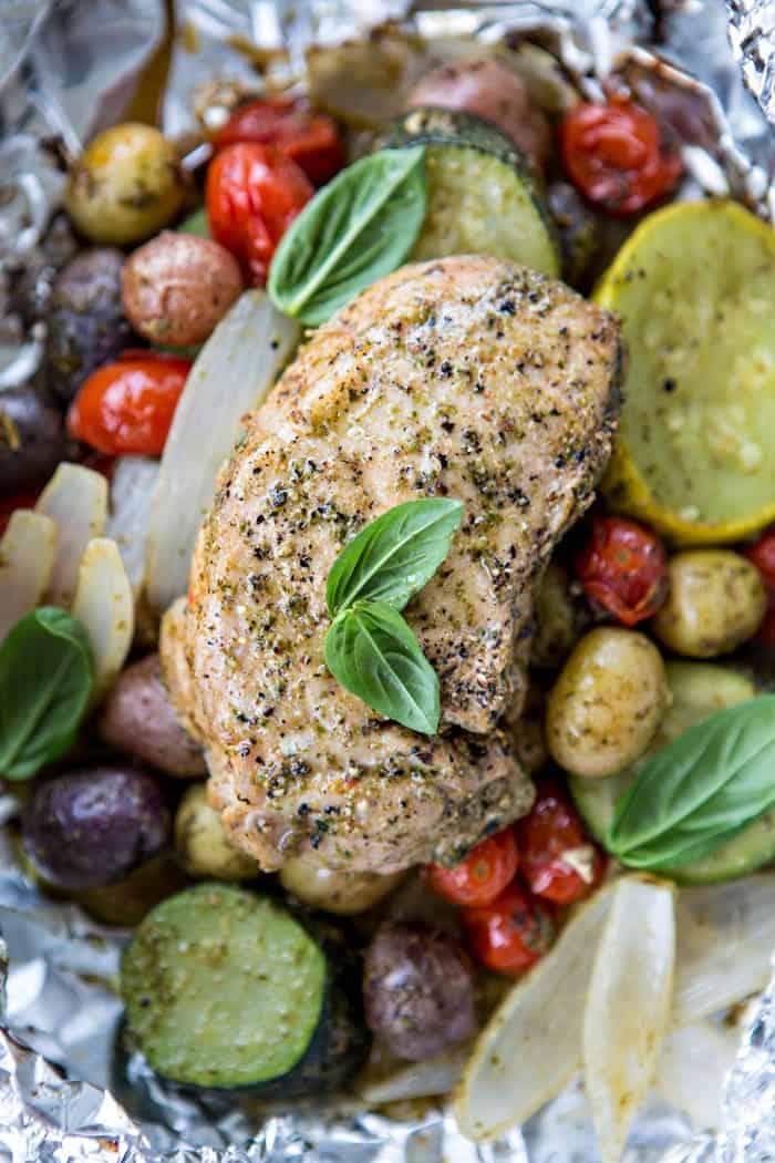 Pesto Pork Chop and Summer Vegetable Foil Dinners