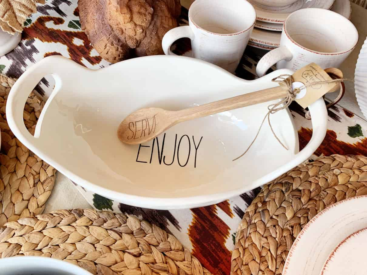White bowl with handles that says Enjoy