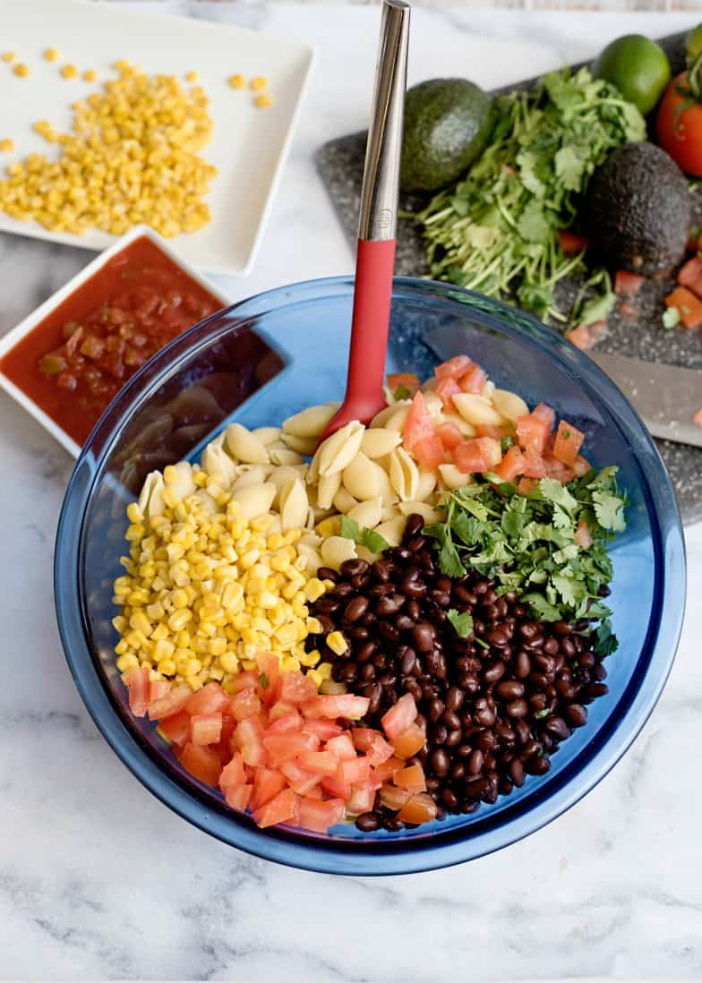 assembling ingredients for mexican pasta salad recipe