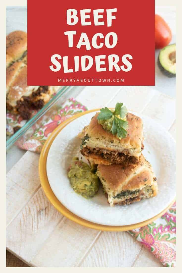 beef taco sliders on a plate with guacamole