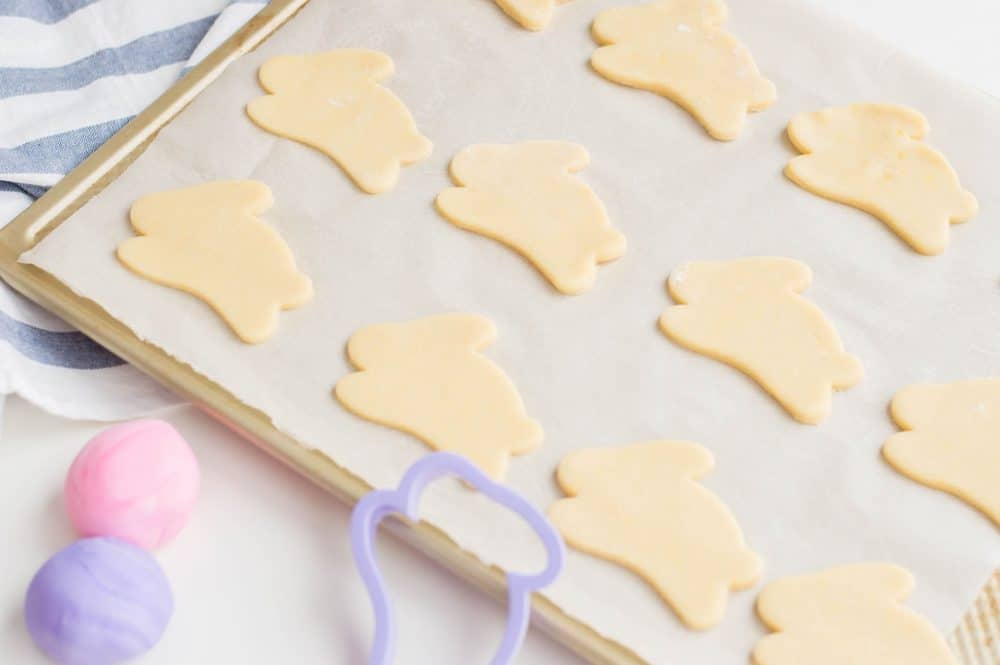 bunny shaped sugar cookies on a cookie sheet