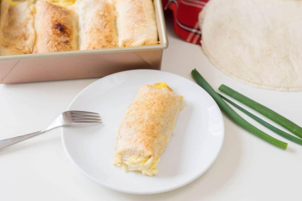 breakfast enchilada on a white plate