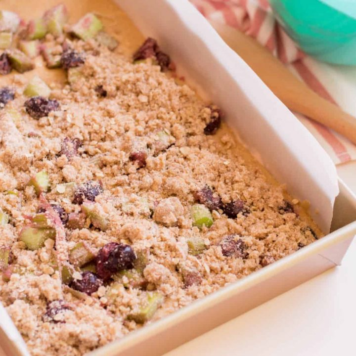 layer-cake-base-with-rhubarb-and-cherry-mixture.-Top-with-crumb-mixture