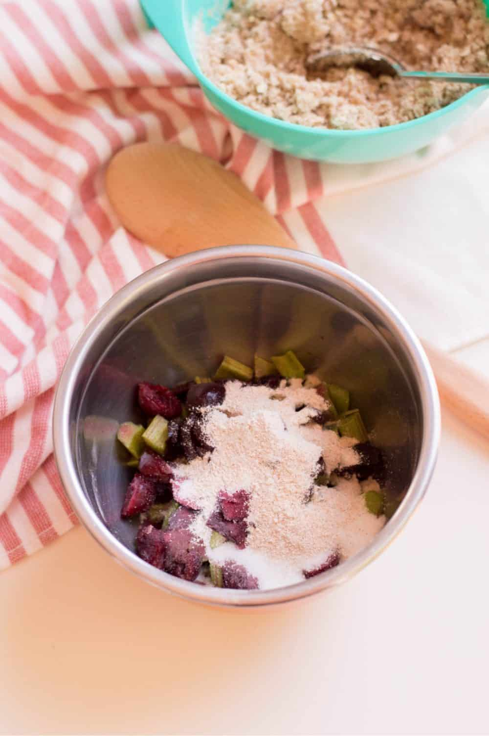 toss cherries and rhubarb with sugar and flour