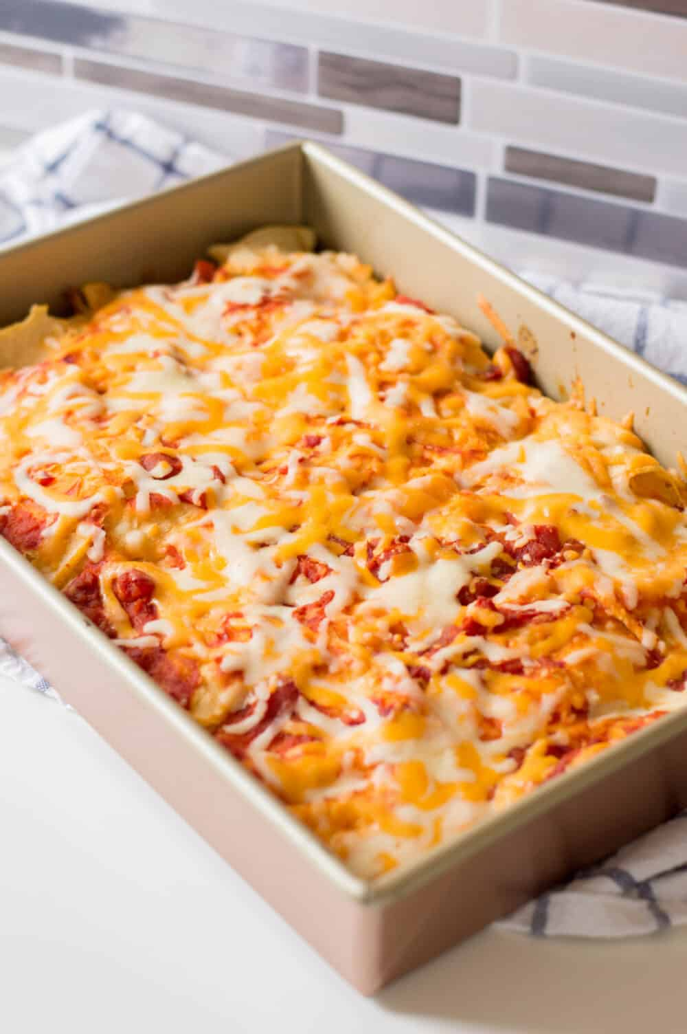 pan of chicken enchilada casserole fresh out of the oven