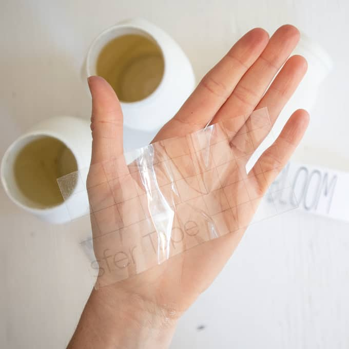 transfer tape on a person's hand